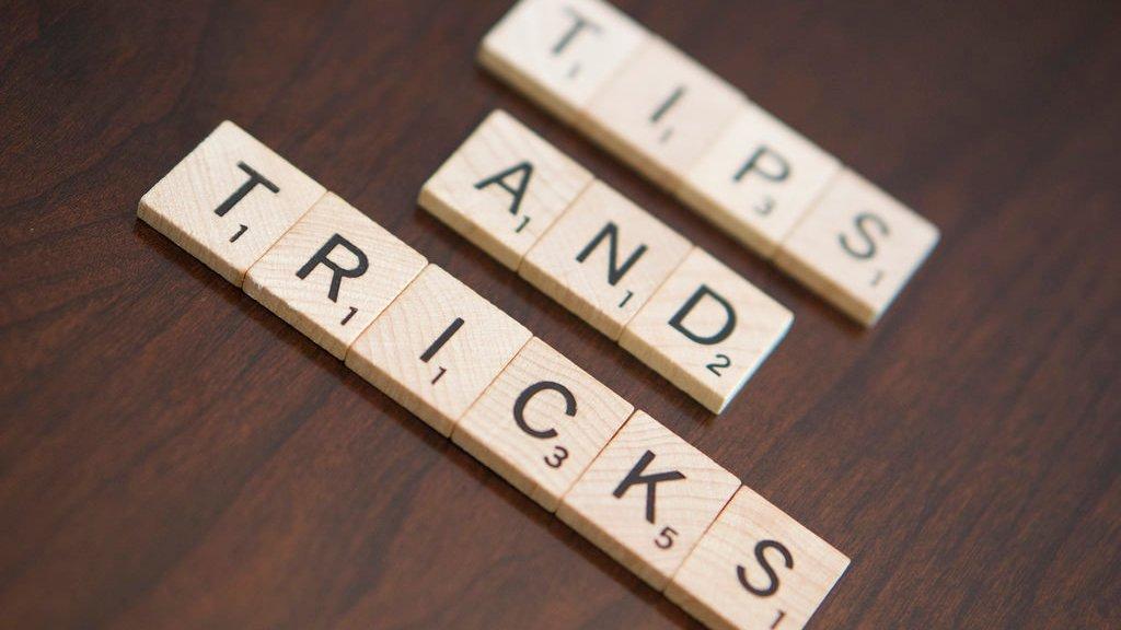"Scrabble tiles spelling ""Tips and Tricks"""