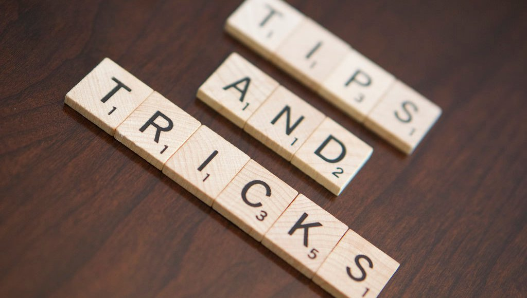 "Scrabble tiles spelling ""Tips and Tricks"""