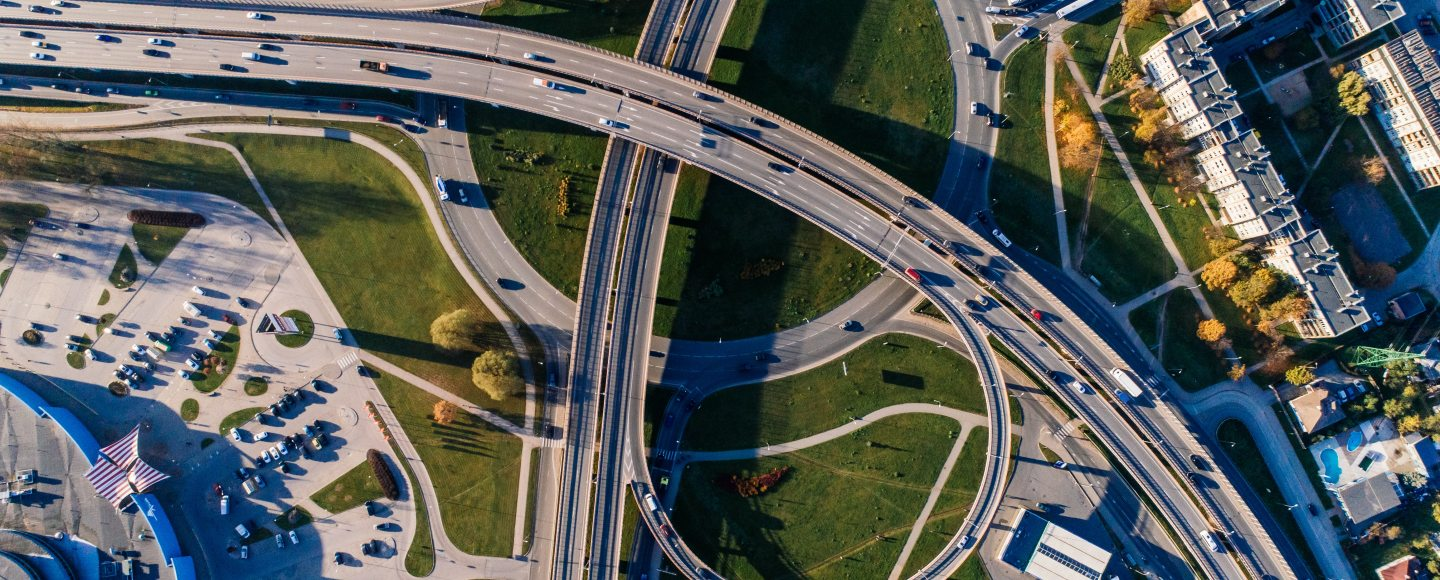 An aerial view of a highway and the buildings around it