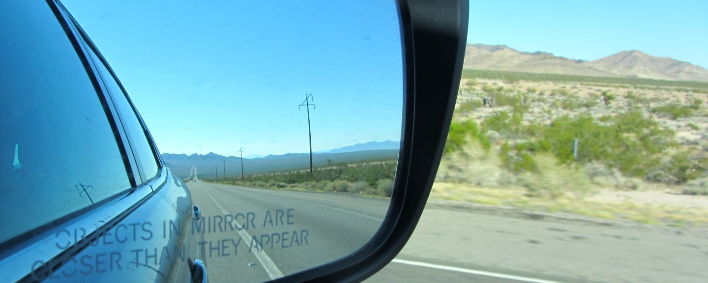 """Picture of a side mirror of a car with the phase, """"Objects in Mirror are Closer than They Appear"""""""