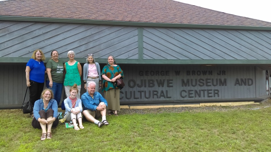Picture of people standing outside of the Ojibwe Museum and Cultural Center on the Lac du Flambeau reservation in Wisconsin