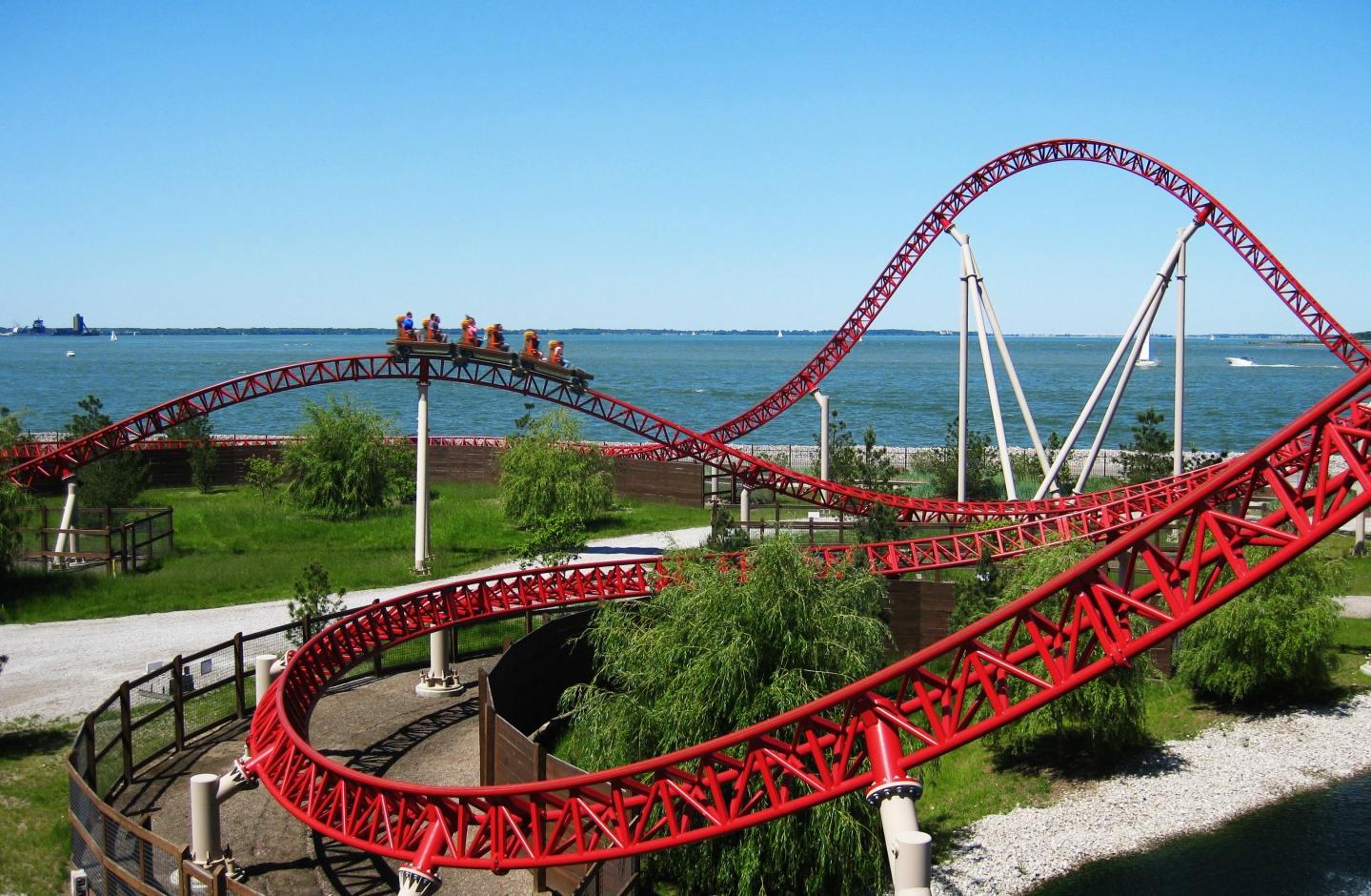 A picture of a roller coaster, near a body of water