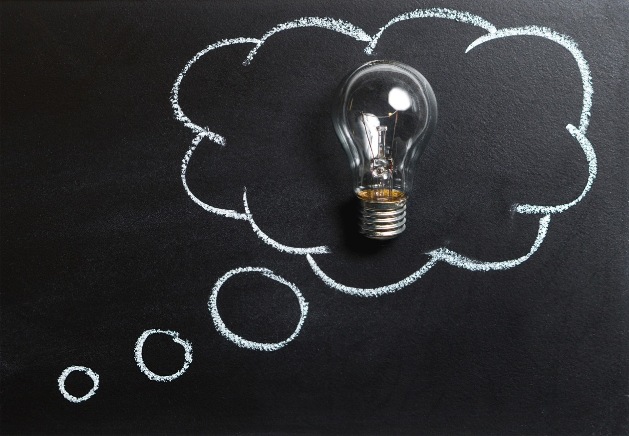 Black screen with a lightbulb and a thought bubble around the lightblub, written in chalk