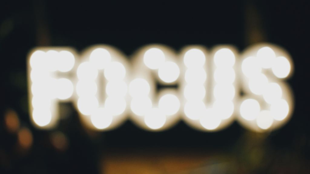 "The word ""FOCUS"" in lights, slightly blurry"