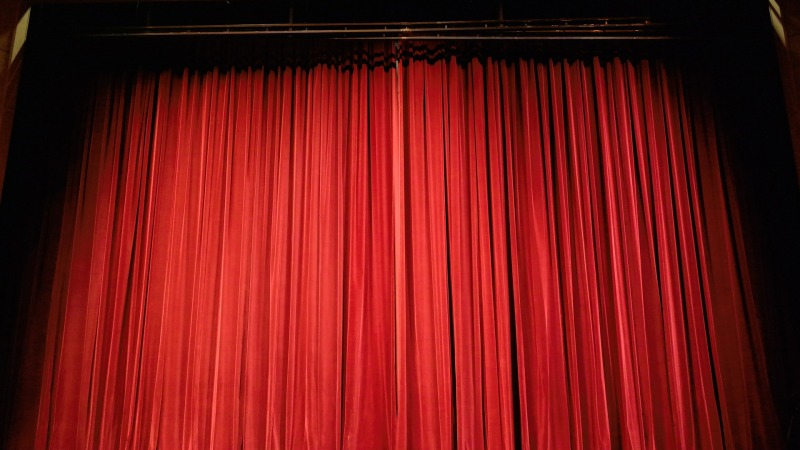 A picture of a closed, red theater curtain