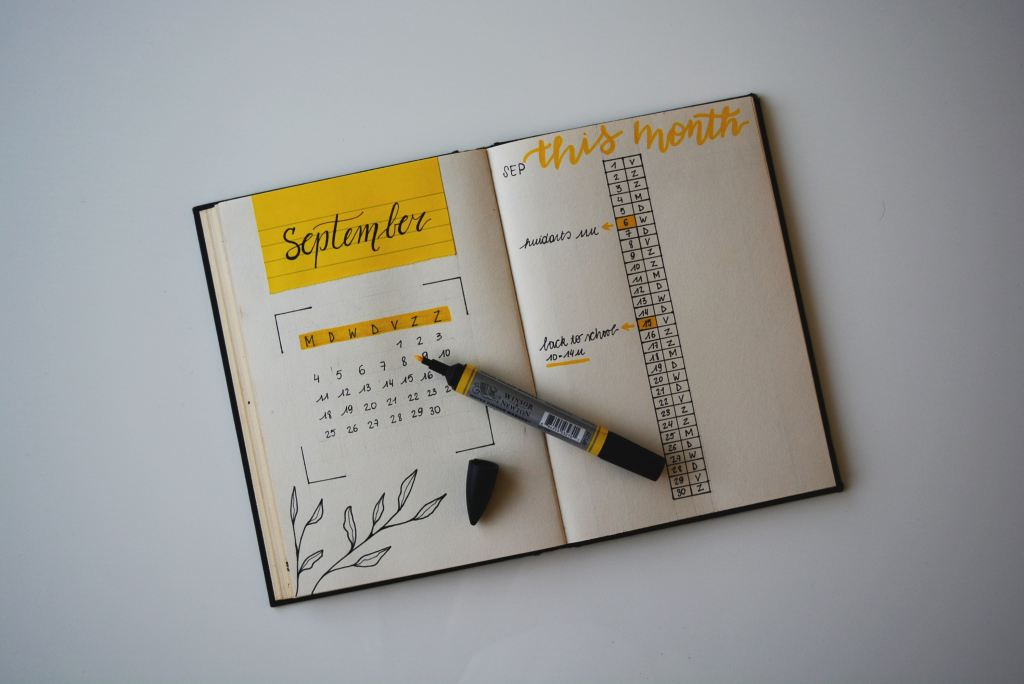 Bullet journal open on desk with yellow highlighter